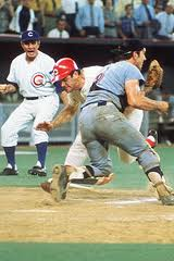 Pete Rose, in red cap, sacks quarterback Ray Fosse...wait, that isn't football?