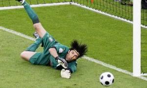 Buffon making a save, using hair to slow down.