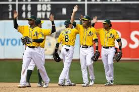 The A's go through celebratory high-fives. This happens a lot.