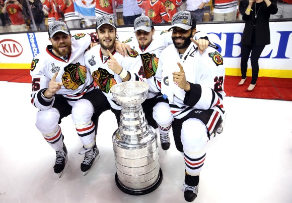 The Blackhawks celebrate with the Cup. And they had to go through the Western Conference to win it.