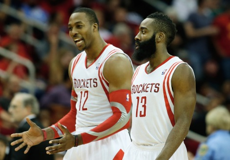 HOUSTON, TX - NOVEMBER 11:  Dwight Howard #12 and James Harden #13 of the Houston Rockets walk off the court during the game against the Toronto Raptors at Toyota Center on November 11, 2013 in Houston, Texas. NOTE TO USER: User expressly acknowledges and agrees that, by downloading and or using this photograph, User is consenting to the terms and conditions of the Getty Images License Agreement.  (Photo by Scott Halleran/Getty Images)