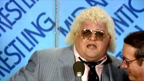"Dusty Rhodes cutting his famous ""Hard Times"" promo."