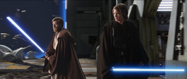 "In this photo provided by Lucasfilm/Twentieth Century Fox, Obi-Wan Kenobi (Ewan McGregor, left) and Anakin Skywalker (Hayden Christensen) launch a daring rescue attempt aboard an enemy ship, in ""Star Wars: Episode III Revenge of the Sith.""  (AP Photo/ Lucasfilm/Twentieth Century Fox)"
