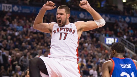 Toronto Raptors center Jonas Valanciunas (17) celebrates his dunk in the last minute first half NBA basketball game action against the Philadelphia 76ers in Toronto on Wednesday, April 9, 2014. THE CANADIAN PRESS/Peter Power