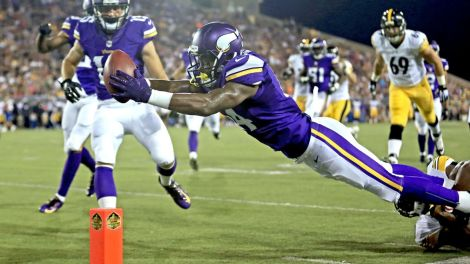 Wide receiver Stefon Diggs dives for a touchdown