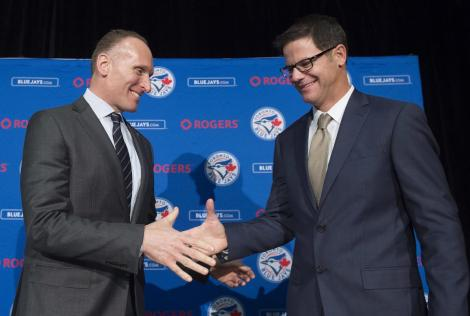 Toronto Blue Jays new general manager Ross Atkins, right, and Blue Jays president and CEO Mark Shapiro shake hands during a press conference in Toronto on Friday, Dec. 4, 2015. (Nathan Denette/The Canadian Press via AP)