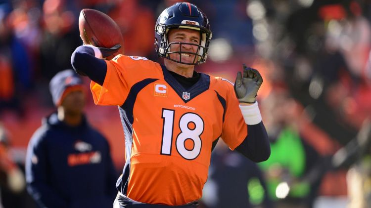 Peyton Manning grimaces as he throws a pass on Sunday afternoon.