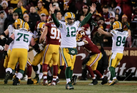 Aaron Rodgers celebrates a win in Washington.