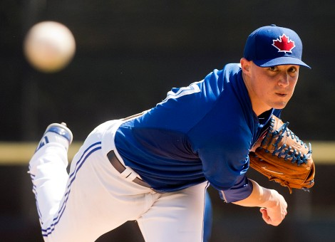 Toronto Blue Jays starting pitcher Aaron Sanchez warms up before playing against the Pittsburgh Pirates in Grapefruit League baseball action in Dunedin, Fla., on Tuesday, March 3, 2015. THE CANADIAN PRESS/Nathan Denette
